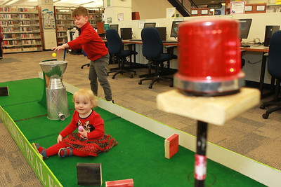 Candace H. Johnson-For Shaw Media Ethan Cisneros, 6, of Third Lake and his sister, Eva Rock, 1, play mini golf during the Grayslake Library Foundation's 9th Annual MiniGolf Fundraiser at the Grayslake Area Public Library.The siblings were with their parents, Randall and Rachael. (2/22/20)