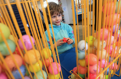 Candace H. Johnson-For Shaw Media Nolan Heuser, 6, of Round Lake Beach picks out a golf ball during the Grayslake Library Foundation's 9th Annual MiniGolf Fundraiser at the Grayslake Area Public Library. Nolan was at the library with his father, Dan, and brother, Conrad, 4. (2/22/20)