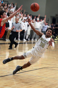 Candace H. Johnson-For Shaw Media Grayslake North's Jamon Thomas (#10) goes down trying to make a shot against Lakes Jake Sanders in the second quarter at Grayslake North High School. Grayslake North won 64-54. (2/25/20)