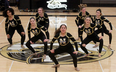 Candace H. Johnson-For Shaw Media Grayslake North's Itzel Gonzalez, 15, (center) with her Dance Team perform their routine at half-time during the boys varsity basketball game against Lakes at Grayslake North High School. Grayslake North won 64-54. (2/25/20)