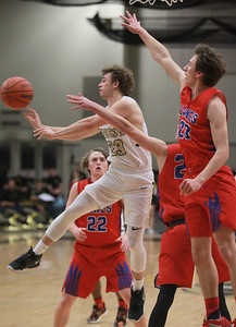 Candace H. Johnson-For Shaw Media Grayslake North's Jason Donohue passes under pressure at the net by Lakes Chance Andell, Matthew Wiechert and Branden Nava in the second quarter at Grayslake North High School. Grayslake North won 64-54. (2/25/20)