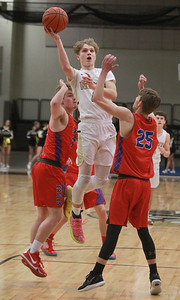 Candace H. Johnson-For Shaw Media Grayslake North's Dominic Jankowski leaps up for a shot against Lakes Tylor Gunther and Matthew Wiechert in the second quarter at Grayslake North High School. Grayslake North won 64-54. (2/25/20)