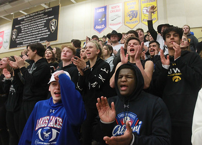 Candace H. Johnson-For Shaw Media Lakes Superfans cheer on their varsity basketball team as they play Grayslake North at Grayslake North High School. Grayslake North won 64-54. (2/25/20)