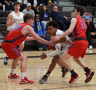 Candace H. Johnson-For Shaw Media Grayslake North's Jamon Thomas drives to the basket against Lakes Tylor Gunther and Jake Sanders in the first quarter at Grayslake North High School. Grayslake North won 64-54. (2/25/20)