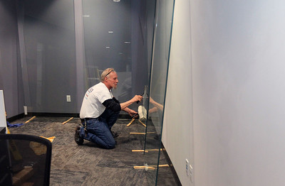 Candace H. Johnson-For Shaw Media Jim Palmer, of Milwaukee, Wis., a glazier with BGS Glass, cleans the glass windows that will go in for the Alpha Media radio stations under construction at Gurnee Mills. The radio stations include: WXLC, WIIL, WLIP and WKRS. (2/19/20)