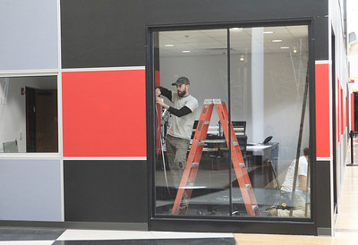 Candace H. Johnson-For Shaw Media Michael Bauer, of Mt. Pleasant, Wis., a glazier with BGS Glass, works on reinforcing the sound proof glass windows for the Alpha Media radio stations under construction at Gurnee Mills. The radio stations include: WXLC, WIIL, WLIP and WKRS. (2/19/20)