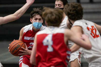 Marian Central Catholic guard/forward Cale McThenia (23) drives the ball during the first quarter of the game at McHenry High School West Campus, Saturday, February 27, 2021.