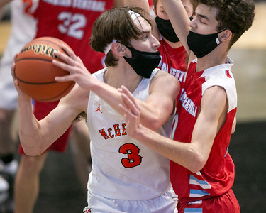 Marian Central Catholic forward Kyle Scatina (10) pressures McHenry guard Matt Gallimore (3) as he looks for a pass during the second quarter of the game at McHenry High School West Campus, Saturday, February 27, 2021.