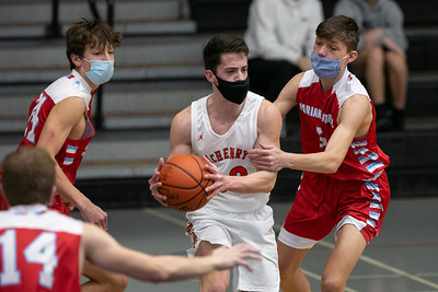 McHenry guard David Wachter (20) looks for a pass during the second quarter of the game at McHenry High School West Campus, Saturday, February 27, 2021.
