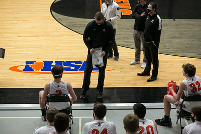 McHenry head coach Chris Madson leads a distanced timeout during the first quarter of the game at McHenry High School West Campus, Saturday, February 27, 2021.