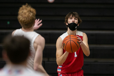 Marian Central Catholic guard Jake Giangrego (1) prepares a shot during the first quarter of the game at McHenry High School West Campus, Saturday, February 27, 2021.