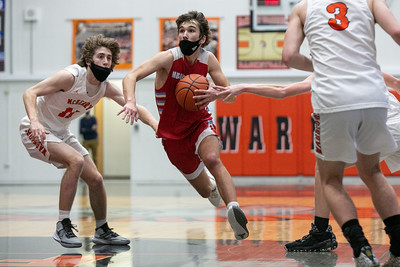 Marian Central Catholic guard Jake Giangrego (1) drives to the basket during the third quarter of the game at McHenry High School West Campus, Saturday, February 27, 2021.