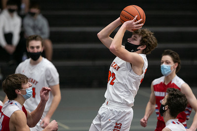 McHenry forward Anthony Fowler (32) attempts a shot during the second quarter of the game at McHenry High School West Campus, Saturday, February 27, 2021.