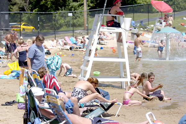 Sandy Bressner – sbressner@kcchronicle.com<br /> Patrons swim and play in the sand Wednesday at Harold Hall Quarry Beach in Batavia.