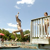 Sandy Bressner – sbressner@kcchronicle.com<br /> A girl jumps into the water from a diving platform at Harold Hall Quarry Beach in Batavia Wednesday afternoon. Quarry Beach counts on hot days to keep the water warm enough to swim, which have been few and far between this summer.