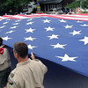 Boy Scout troops carry the American Flag during the 67th Swedish Days Parade on June 26 in Geneva.