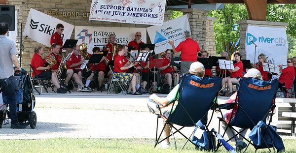 The Batavia Community Band performs during a Flag Day observance at the Batavia Riverwalk on June 11.