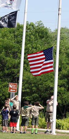 The Boy Scouts raise the American flag during a Flag Day observance at the Batavia Riverwalk on June 11.