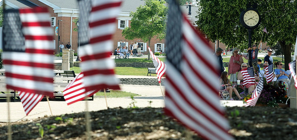 People gather for a Flag Day observance at the Batavia Riverwalk on June 11.