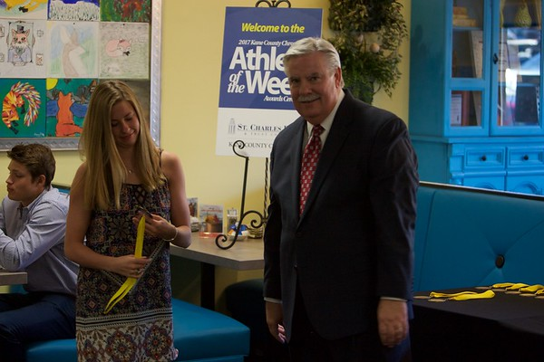 Rosary swimmer Carmen Streid accepts her medal from Tom Hansen at the 2017 Kane County Chronicle Athlete of the Week Awards Banquet on June 7 at Abby's in St. Charles.