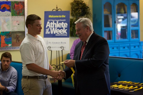 St. Charles East baseball player Drew Conn accepts his medal from Tom Hansen at the 2017 Kane County Chronicle Athlete of the Week Awards Banquet on June 7 at Abby's in St. Charles.