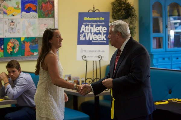 Margaret Whitley accepts her medal from Tom Hansen at the 2017 Kane County Chronicle Athlete of the Week Awards Banquet on June 7 at Abby's in St. Charles.