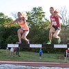 Becca Richtman a senior at Kaneland, left, competes in the 2000 meter steeplechase June 10, during the Midwest Distance Classic at Benedicitine University in Lisle.<br /> David Toney for Shaw Media