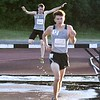 Kaneland sophomore Jacob Petrik (13) jumps over the water barrier in the 2000 meter steeplecase June 10, during the Midwest Distance Classic at Benedicitine University in Lisle.<br /> David Toney for Shaw Media
