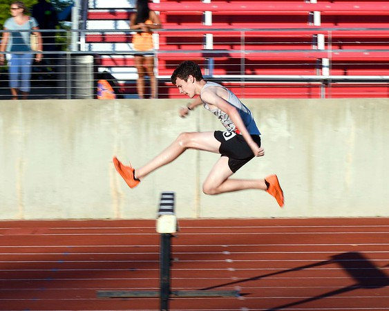 Ryan Kredell a a sophomore at Geneva competes in the 2000 meter steeplechase June 10, during the Midwest Distance Classic at Benedicitine University in Lisle.<br /> David Toney for Shaw Media