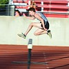 Andrew Kantola a senior at Kaneland jumps over the last hurdle in the 2000 meter steeplechase June 10, during the Midwest Distance Classic at Benedicitine University in Lisle.<br /> David Toney for Shaw Media