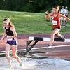 Grace Purcell a sophomore from Kaneland (right) competes in the 2000 meter steeplechase June 10, during the Midwest Distance Classic at Benedicitine University in Lisle.<br /> David Toney for Shaw Media