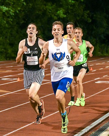 Tyler Dau (front) of Geneva and Matt Richtman of Kaneland (left) run the 3200 meter on the back straight away June 10, during the Midwest Distance Classic at Benedicitine University in Lisle.<br /> David Toney for Shaw Media