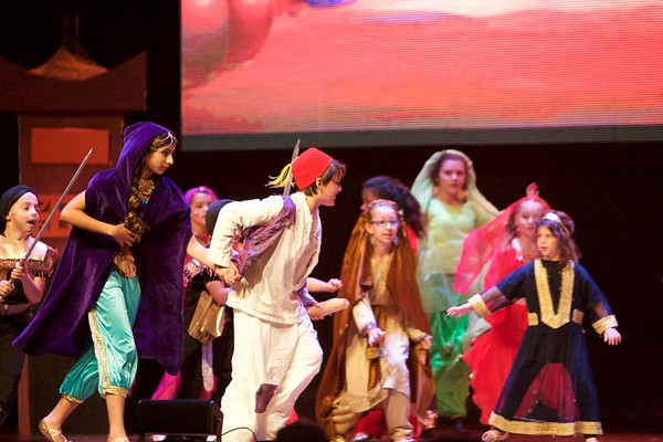 Jasmine, played by Katie Das, and Aladdin, played by Jonah Zimmermann, run from the towns people during a performance of Aladdin Junior at the Arcada Theatre in St. Charles June 25.