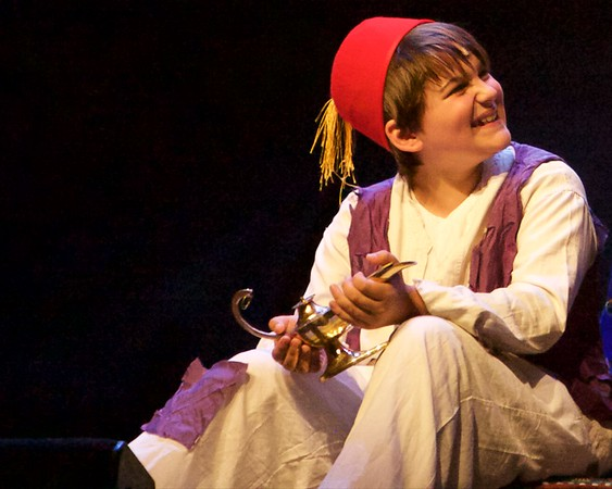 Aladdin, played by Jonah Zimmermann, holds the magic lamp during a performance of Aladdin Junior at the Arcada Theatre in St. Charles June 25.