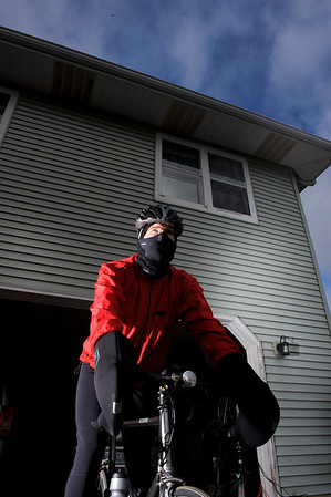 Daniel J. Murphy - dmurphy@shawmedia.com  Jay Marshall stands on his bicycle in preparation for a winter ride from his home January 2, 2012 in Richmond. Jay often rides his bicycle for 20 miles in temperatures lower than 20 degrees Fahrenheit.