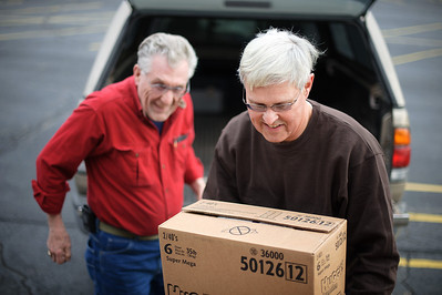 Daniel J. Murphy - dmurphy@shawmedia.com  Al Robel (left) of Johnsburg and Larry Eils (right) of Harvard unload boxes of diapers at St. Paul Episcopal Church Tuesday January 3, 2012 in McHenry. The church is desperately in need of a new location to store its large bank of diapers.