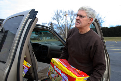Daniel J. Murphy - dmurphy@shawmedia.com  Larry Eils of Harvard unloads boxes of donated diapers at St. Paul Episcopal Church Tuesday January 3, 2012 in McHenry. The church is desperately in need of a new location to store its large bank of diapers.