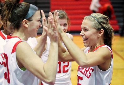 Jenny Kane - jkane@shawmedia.com Tues. Jan. 3, 2012, Dundee-Crown's Maddie Cavallaro, (left) and Sammy Murray, (right) celebrate after their victory against Huntley at Dundee. Dundee-Crown won 44-41.