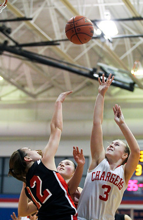Jenny Kane - jkane@shawmedia.com Tues. Jan. 3, 2012, Dundee-Crown's Carlin Faulkner tries to take a shot as Huntley's Haley Ream blocks during the third period. Dundee-Crown defeated Huntley 44-41 at Dundee.
