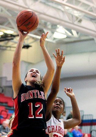 Jenny Kane - jkane@shawmedia.com Tues. Jan. 3, 2012, Dundee-Crown's Diamond Williams tries block Huntley's Haley Ream shot during the fourth period. Dundee-Crown defeated Huntley 44-41 at Dundee.