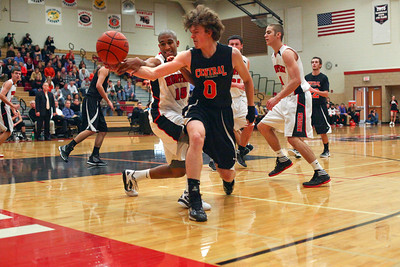 Lauren M. Anderson - landerson@shawmedia.com Huntley's Bryce Only knocks away control of the ball from Crystal Lake Central's Nick Decoster on Wednesday in the third quarter.