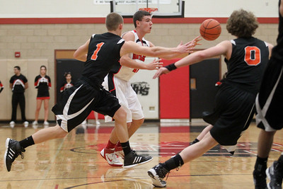 Lauren M. Anderson - landerson@shawmedia.com Huntley's Ryan Craig moves the ball around the court during the second quarter against Crystal Lake Central on Wednesday.