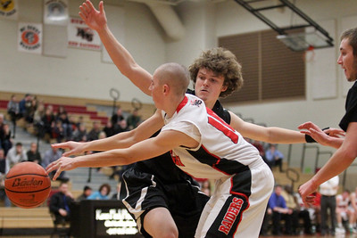 Lauren M. Anderson - landerson@shawmedia.com Crystal Lake Central's Nick Decoster puts on the defensive pressure against Huntley's T.J. Adams on Wednesday in the third quarter.