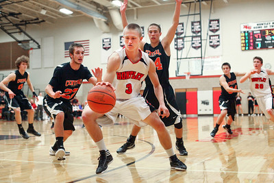 Lauren M. Anderson - landerson@shawmedia.com Huntley's Jake Brock (3) gains control of the ball in the fourth quarter amidst heavy defensive pressure from Crystal Lake Central's Brad Knoeppel (22) and Nick Marchetti (24) on Wednesday. Huntley defeated Central 56-35.
