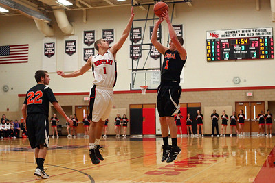 Lauren M. Anderson - landerson@shawmedia.com Huntley's Ryan Lussow (left) contests a shot by Crystal Lake Central's Corban Murphy in the third quarter on Wednesday.