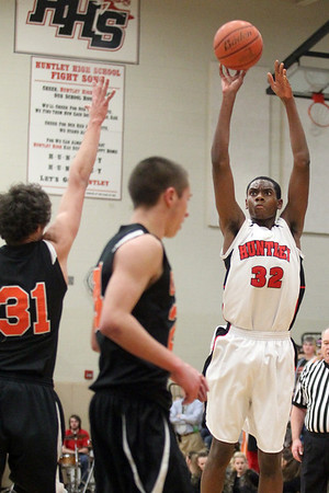 Lauren M. Anderson - landerson@shawmedia.com Huntley's Amanze Egekeze (32) puts up an uncontested shot in the first quarter on Wednesday against Crystal Lake Central. Huntley went on to defeat Central 56-35.