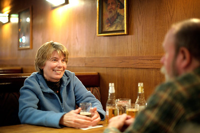 Daniel J. Murphy - dmurphy@shawmedia.com  Peggy Brink of Cary (left) and her husband Tom (right) relax with a cool drink and food on the way Tuesday January 3, 2012 at Chris' Coach House in Cary. The restaurant is celebrating its 30th anniversary this year and is starting to see a new group of younger customers with families coming in as its second and third generation of customers enters the doors.