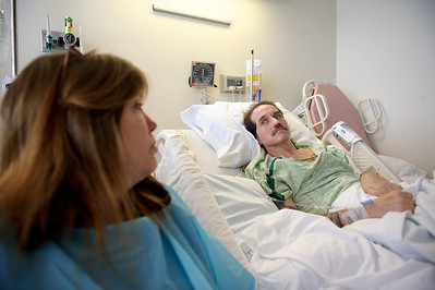 Daniel J. Murphy - dmurphy@shawmedia.com  Veronica Green (left) sits beside Kurt Cleveland (right), her partner of 15 years, at Saint Anthony Medical Center Wednesday January 4, 2012  in Rockford, IL. The Marengo couple spent much of 2011 attempting to cope with a debilitating head trauma that Kurt suffered in a motorcycle accident on Easter.