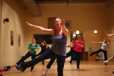 Lauren M. Anderson - landerson@shawmedia.com Kelly Liebman of Wonder Lake participates during a Jazzercise class in Woodstock on Thursday. Beginning in March 2010 Liebman began going to classes to lose weight and become more healthy; she has lost over 20 pounds.   (01/05/2012)