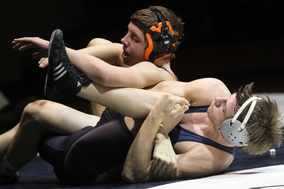 Lauren M. Anderson - landerson@shawmedia.com Cary-Grove's Garrett Glueck (bottom) holds down McHenry's Cody Patchett during their 145-lb match on Thursday. Glueck won the match by decision.